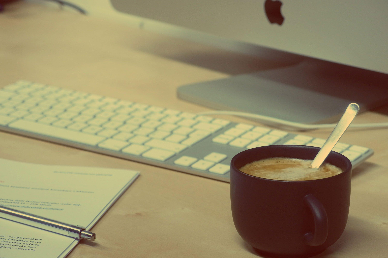 Black Coffee Mug Beside Silver Imac