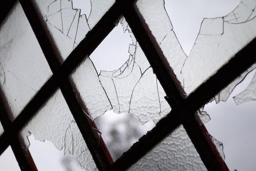 Free stock photo of dark, broken glass, close -up, broken window
