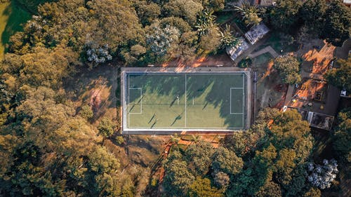 Aerial Photography of Green Field Surrounded by Trees
