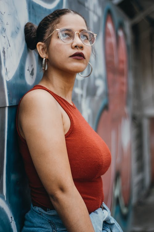 Shallow Focus Photo of Woman Leaning on Wall