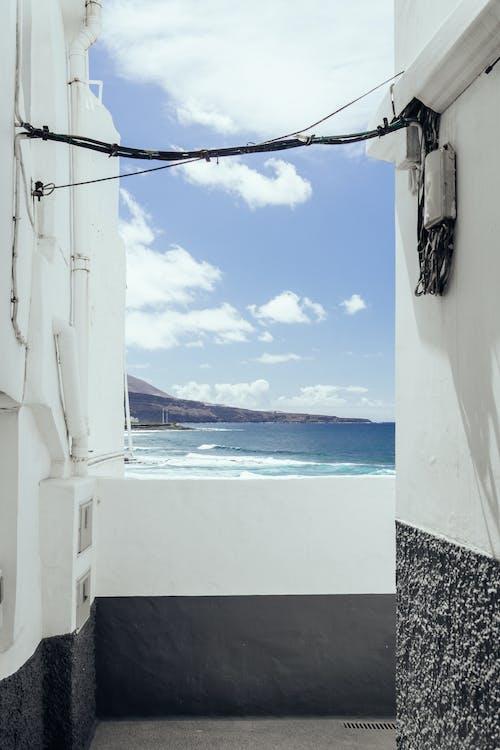 Darmowe zdjęcie z galerii z architektura, chmury, czas wolny, dom