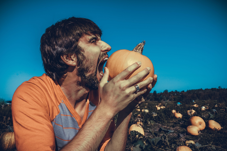 Man Biting Pumpkin Outdoor