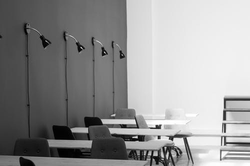 Grayscale Photography of Chairs and Tables
