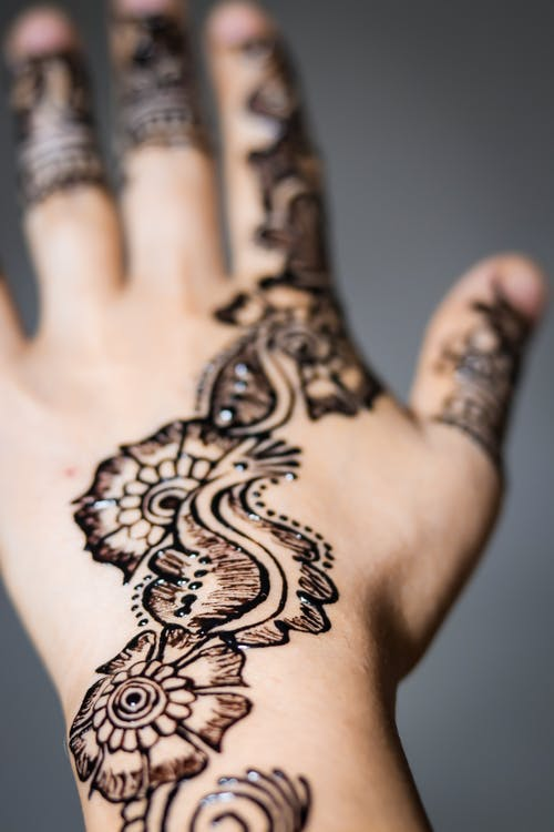 Shallow Focus Photo of Person Showing Mehndi Temporary Tattoo