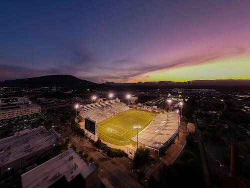 Безкоштовне стокове фото на тему «Аерофотозйомка, Захід сонця, стадіон»