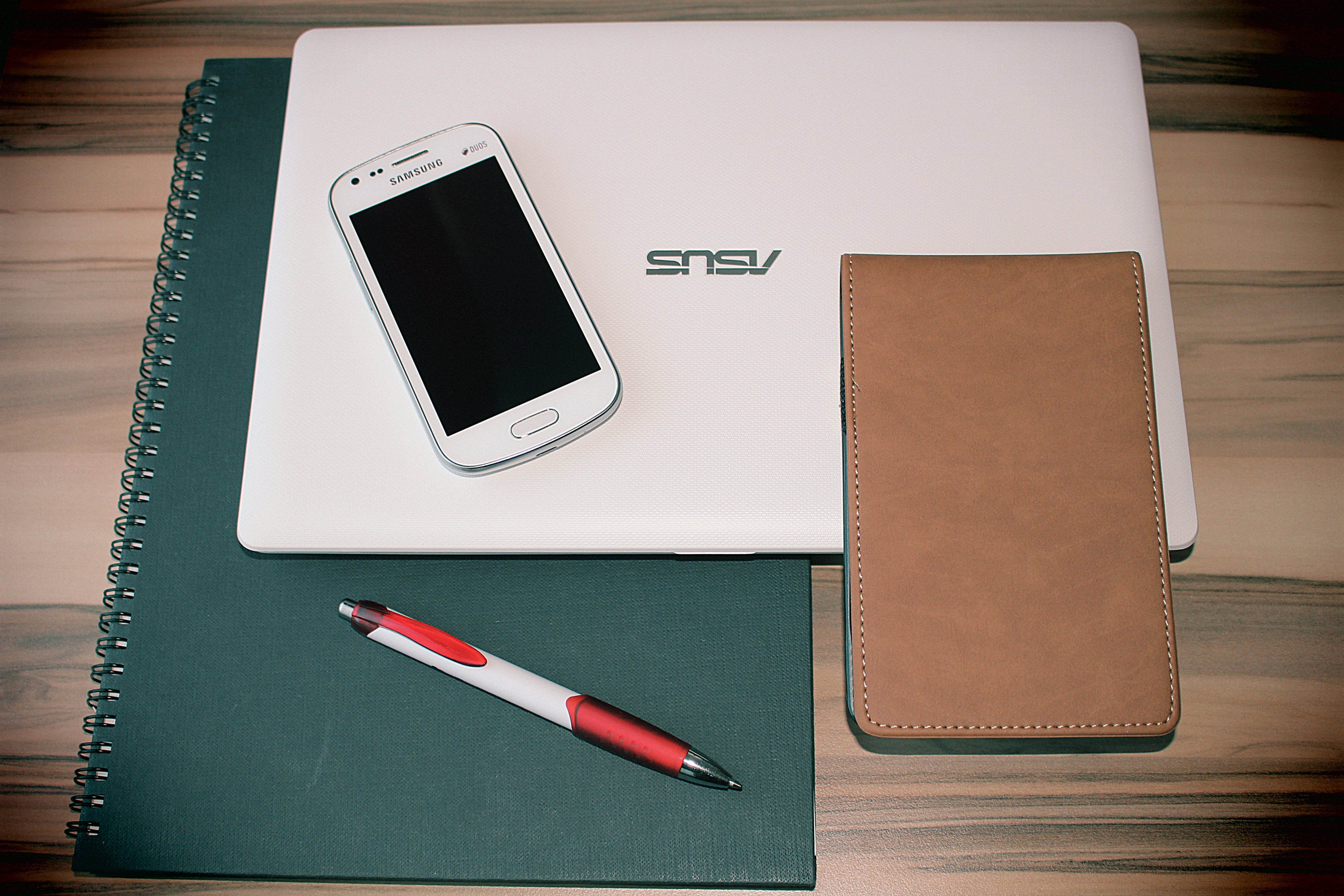 Free stock photo of smartphone, laptop, notebook, pen