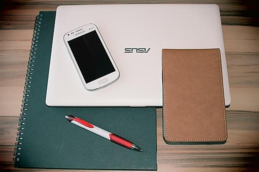 Free stock photo of smartphone, laptop, notebook, pen