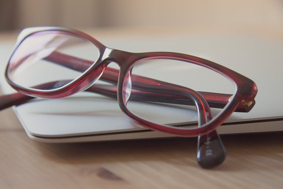 Eyeglasses With Red Frames on Laptop Computer