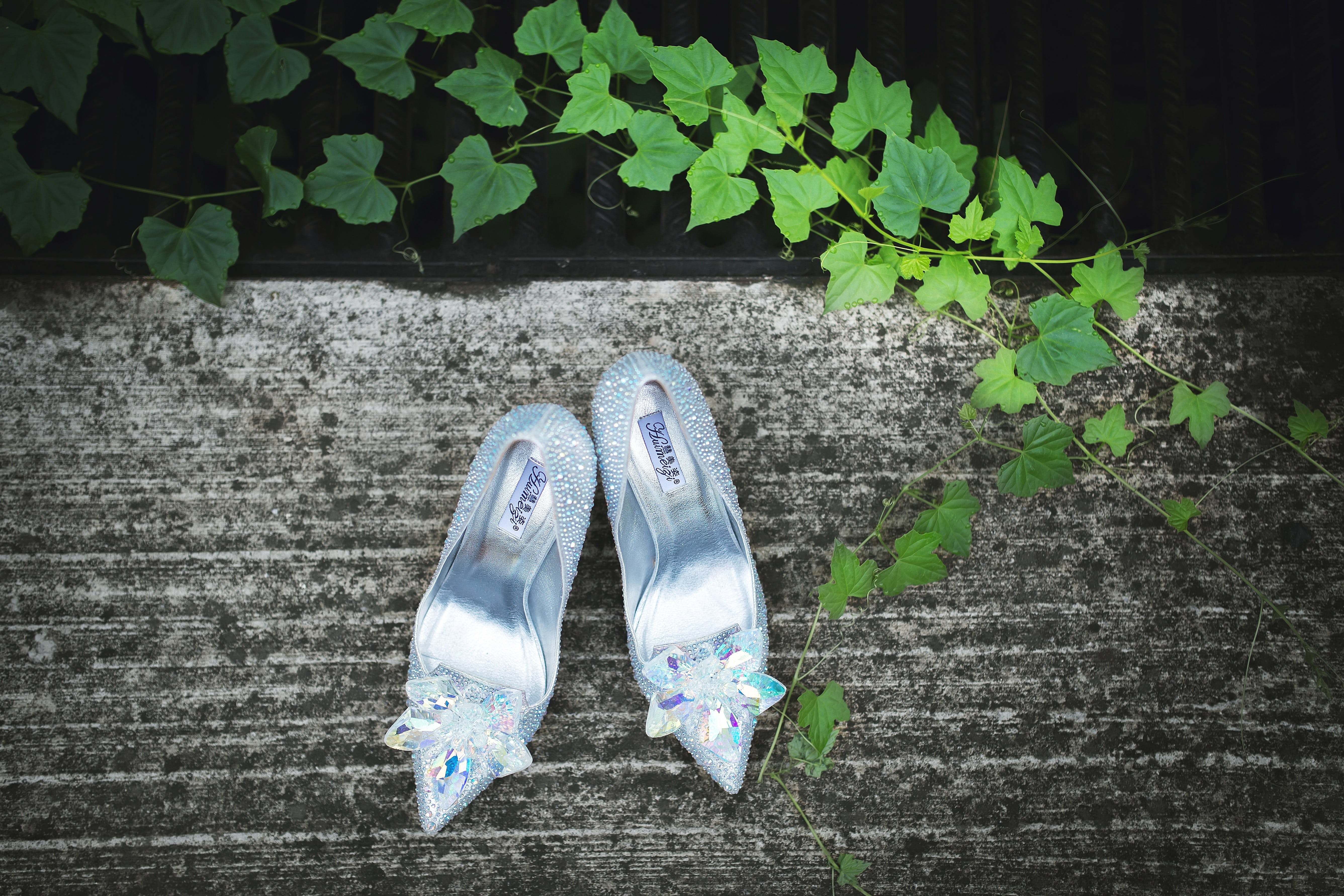 Pair of Silver Pointed-toe Heeled Sandals on Gray Surface