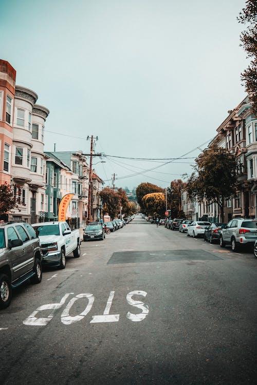 Photos gratuites de nuageux, rue, ville