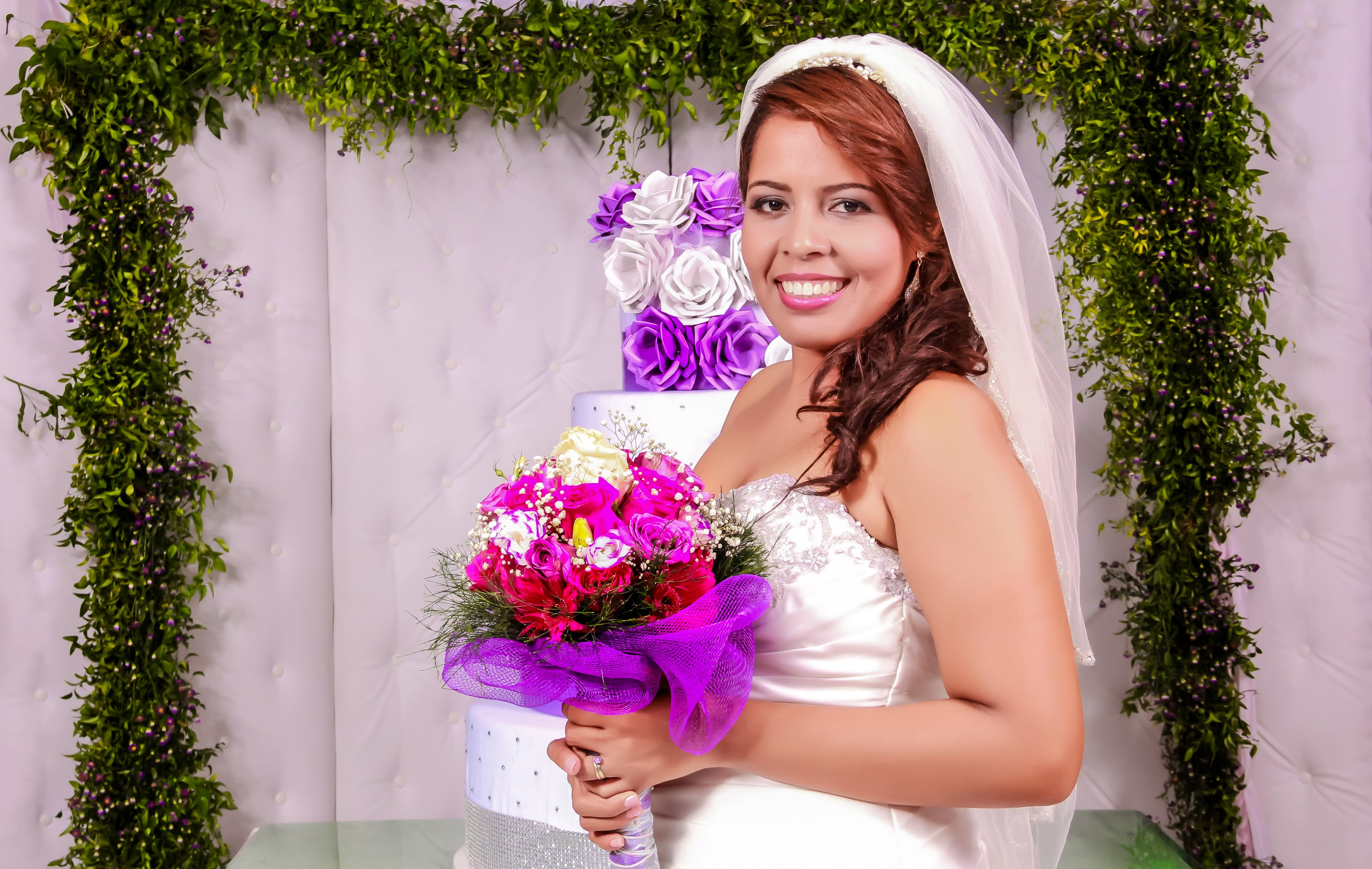 Woman Holding Flower Bouquet in Wedding
