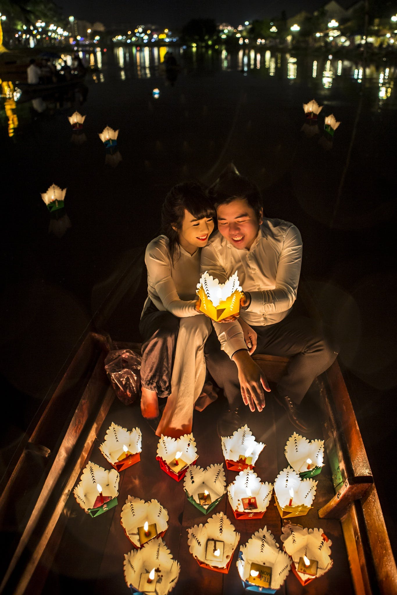 Couple Sitting Holding Paper Lamp