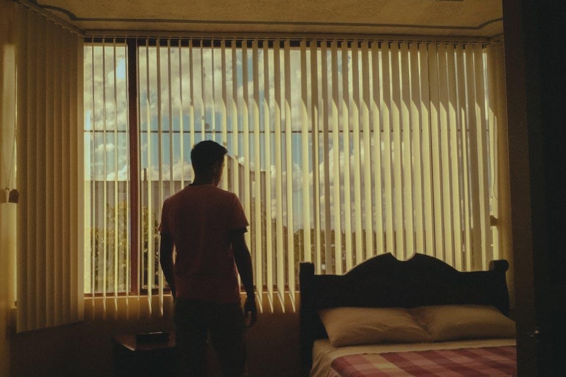 Man Standing Beside Bed