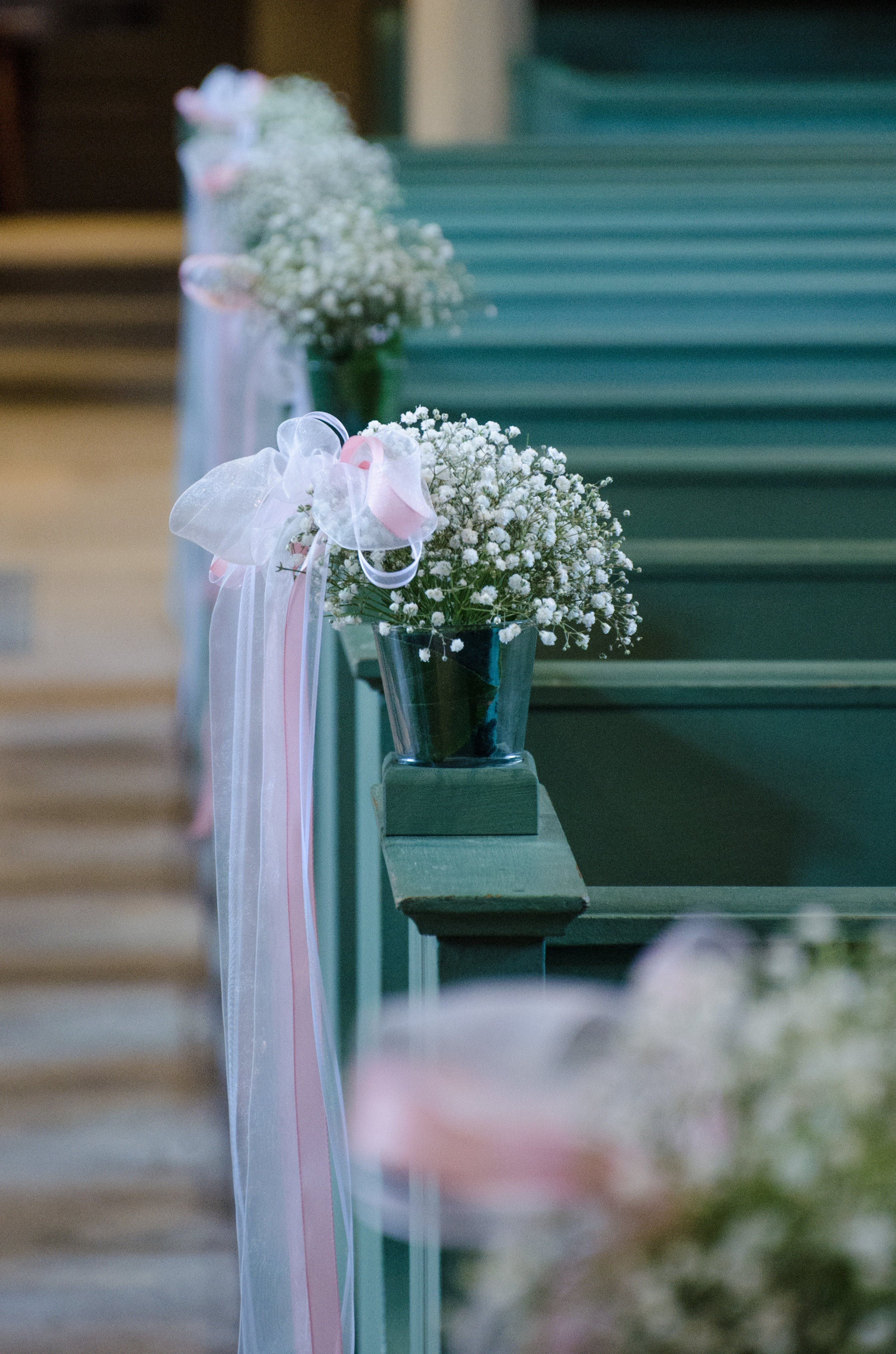 White Potted Flowers With White Textiles