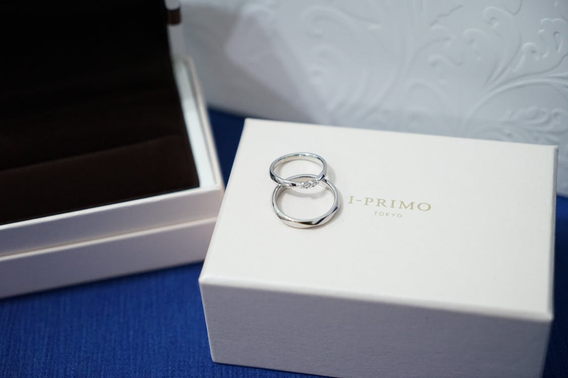 Two Silver-colored Rings With Box