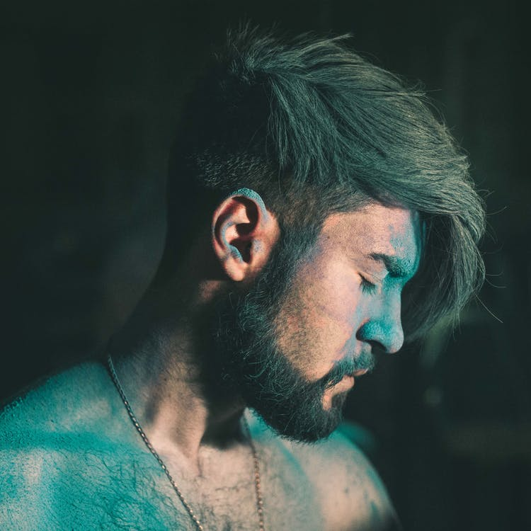 Man Covered in Colored Powder Looking down