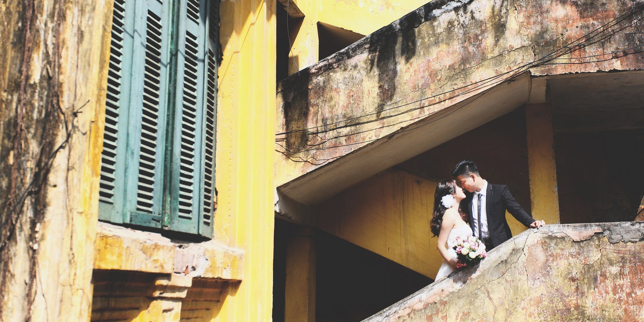 Wedding Couple Standing on Stair While Kissing