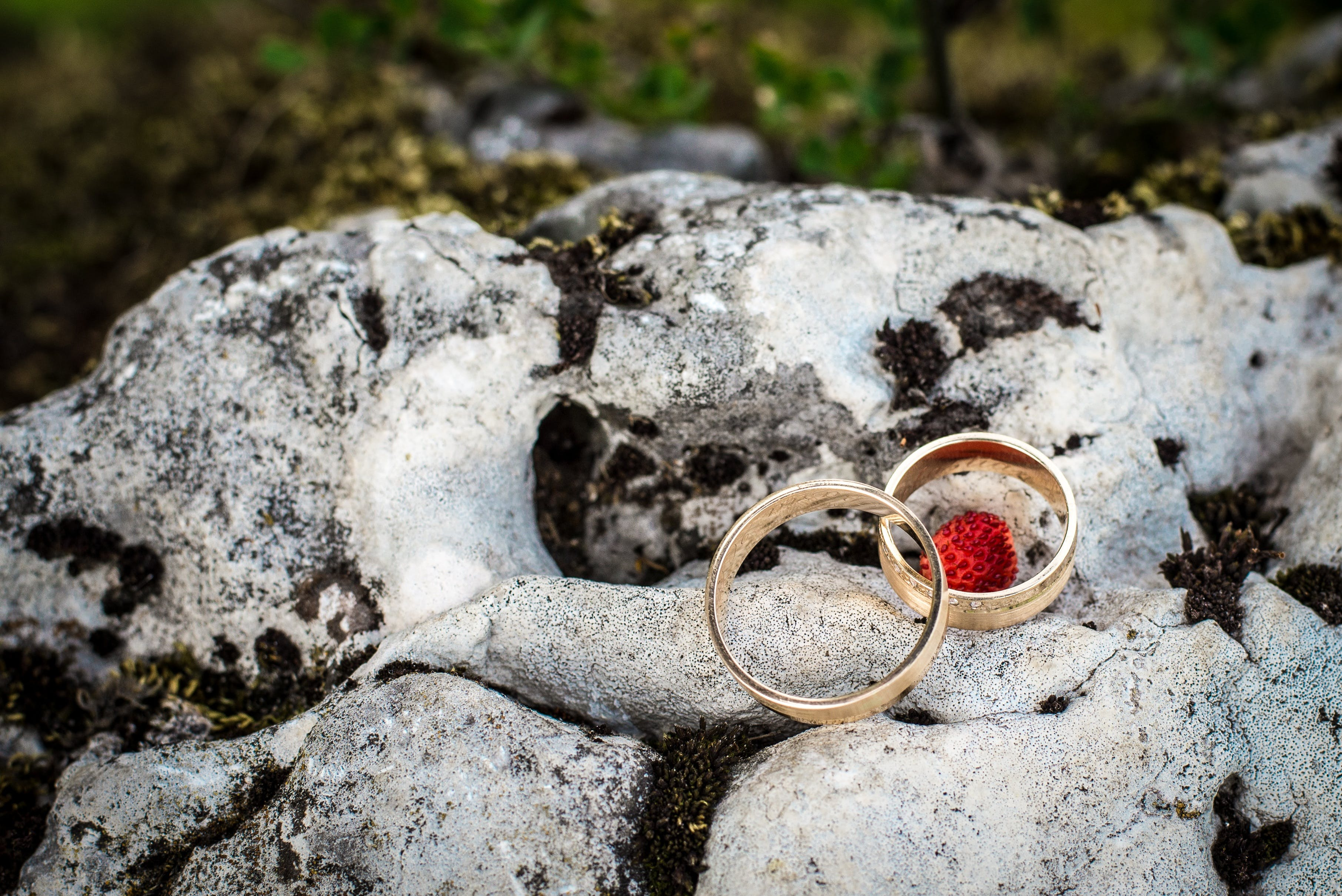 Two Gold-colored Rings on White Stone