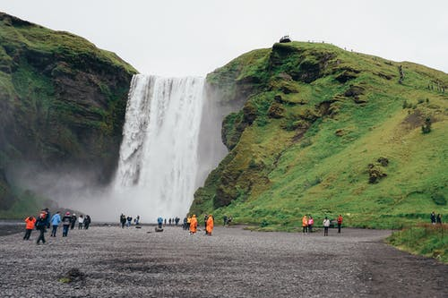 People Standing Near Waterfalls