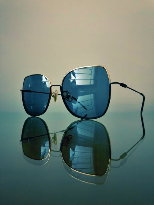 Blue Sunglasses With Silver-colored Frames