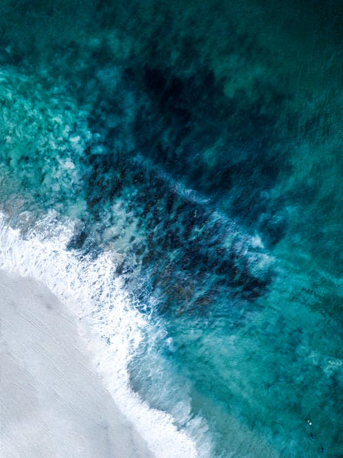 Aerial Photography of Waves Washing Up on  Sandy Beach