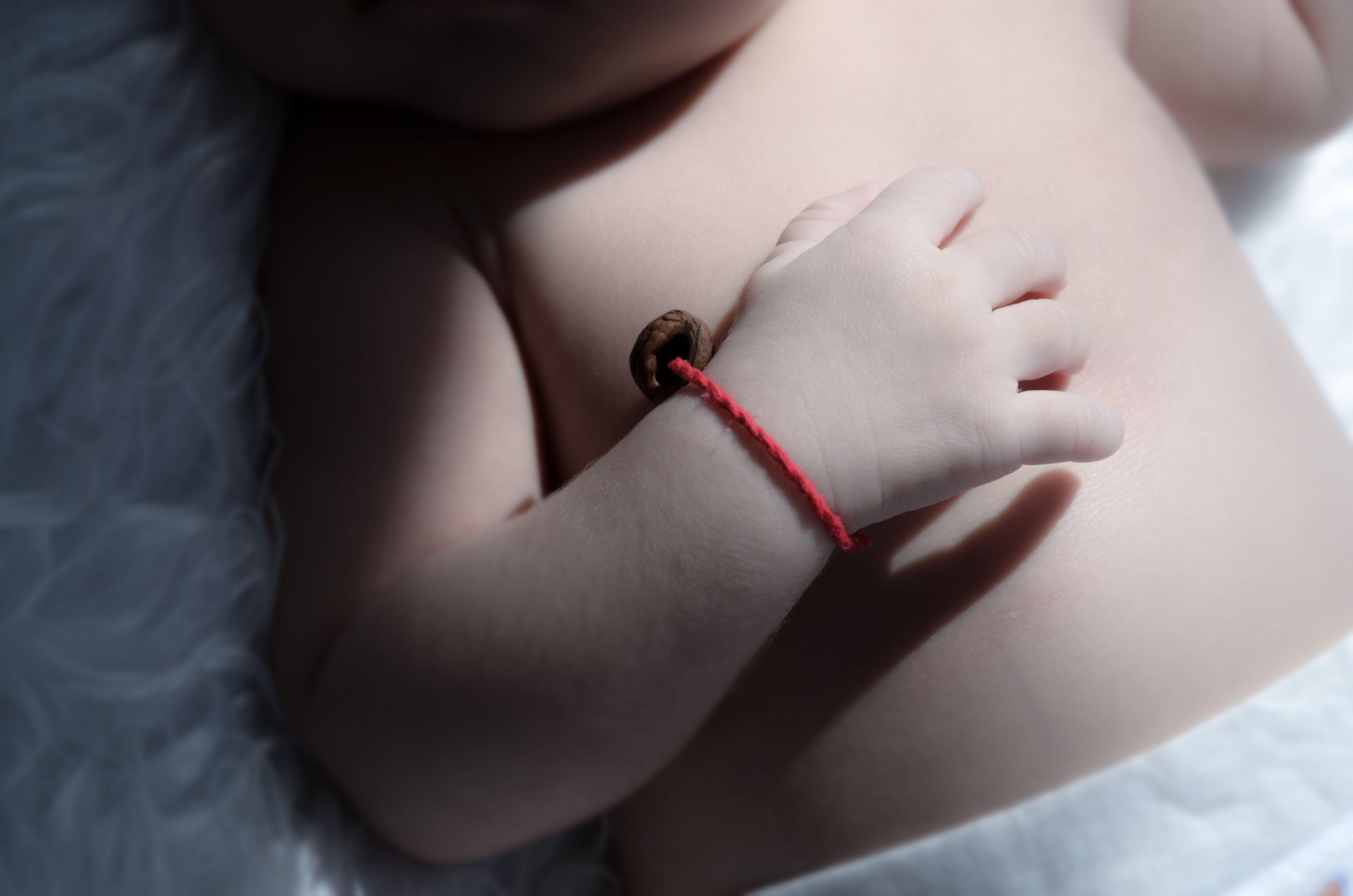 Baby Wearing Red Bracelet