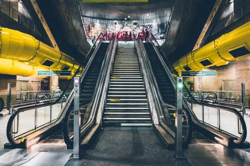 Stair in the Middle of Escalators