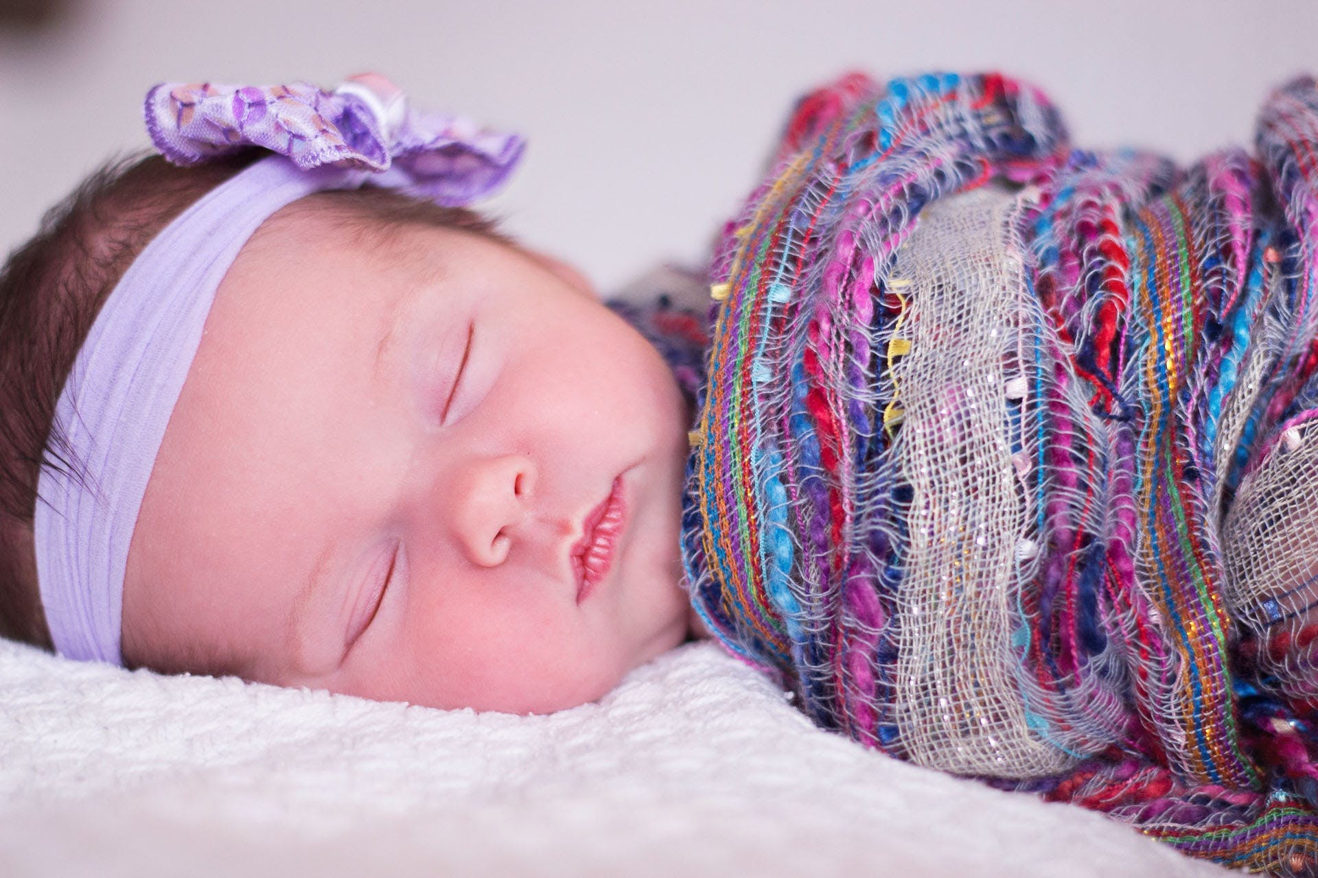 Baby Sleeping With Purple Blanket