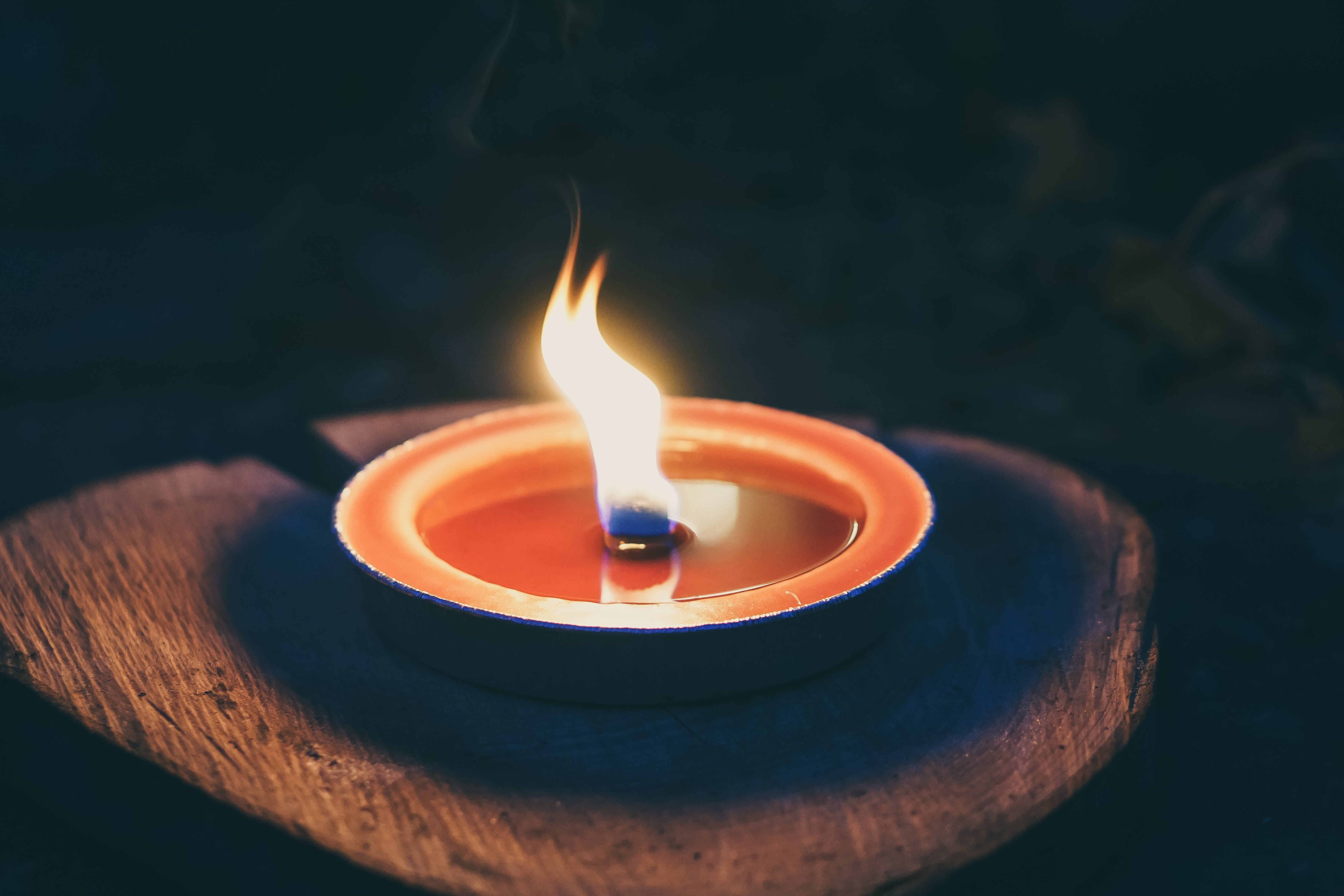 Candle on Wooden Platform