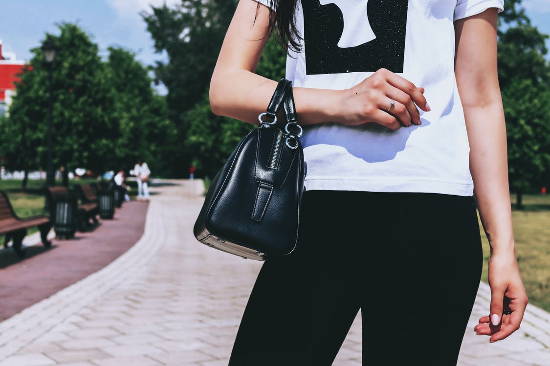 Person With Black Leather Bag Standing Outdoor
