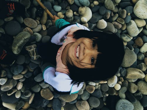 Free stock photo of girl, person, rocks, smiling