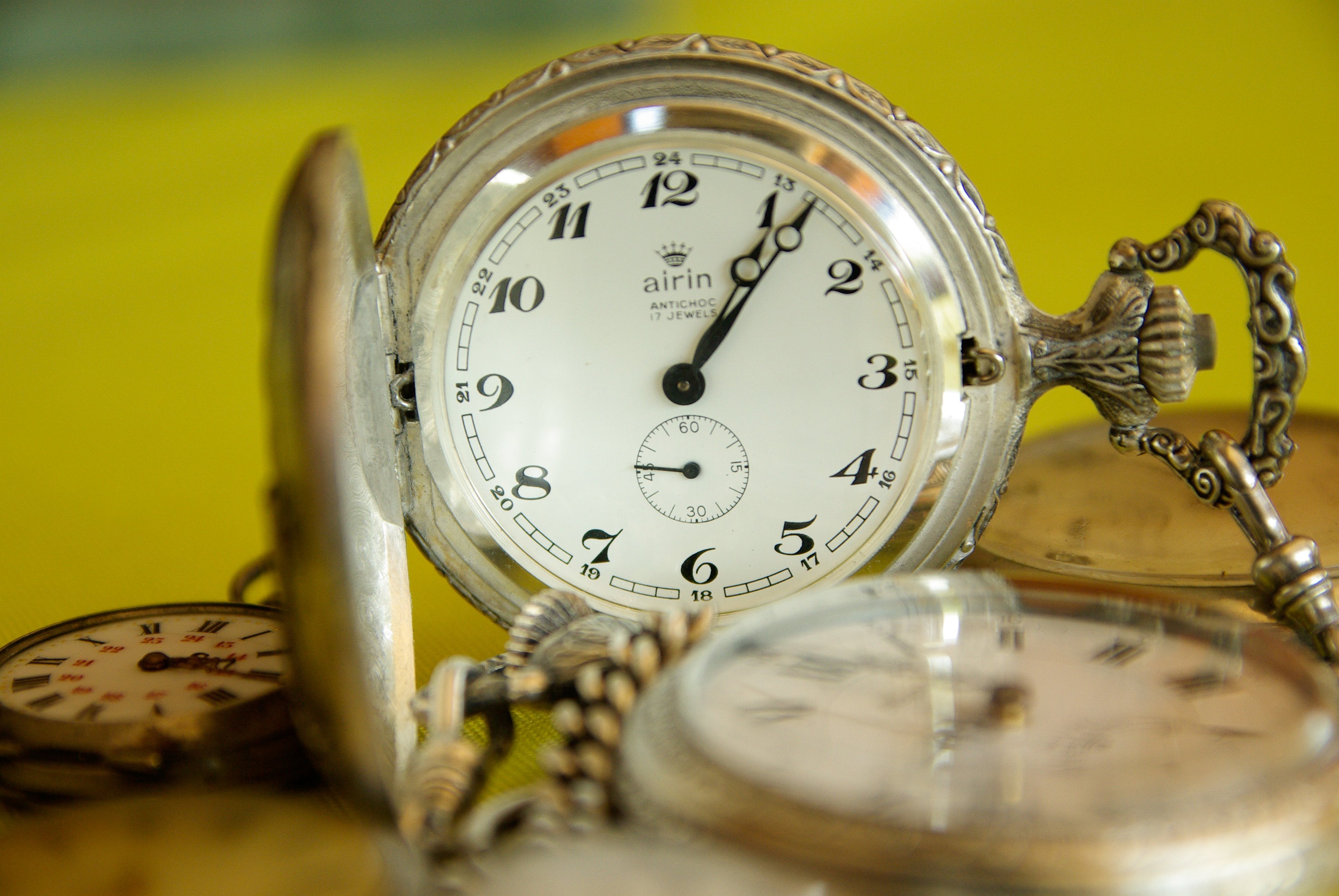 Silver-colored Pocket Watch at 1