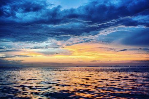 bulutlar, deniz, deniz manzarası, gün batımı içeren Ücretsiz stok fotoğraf