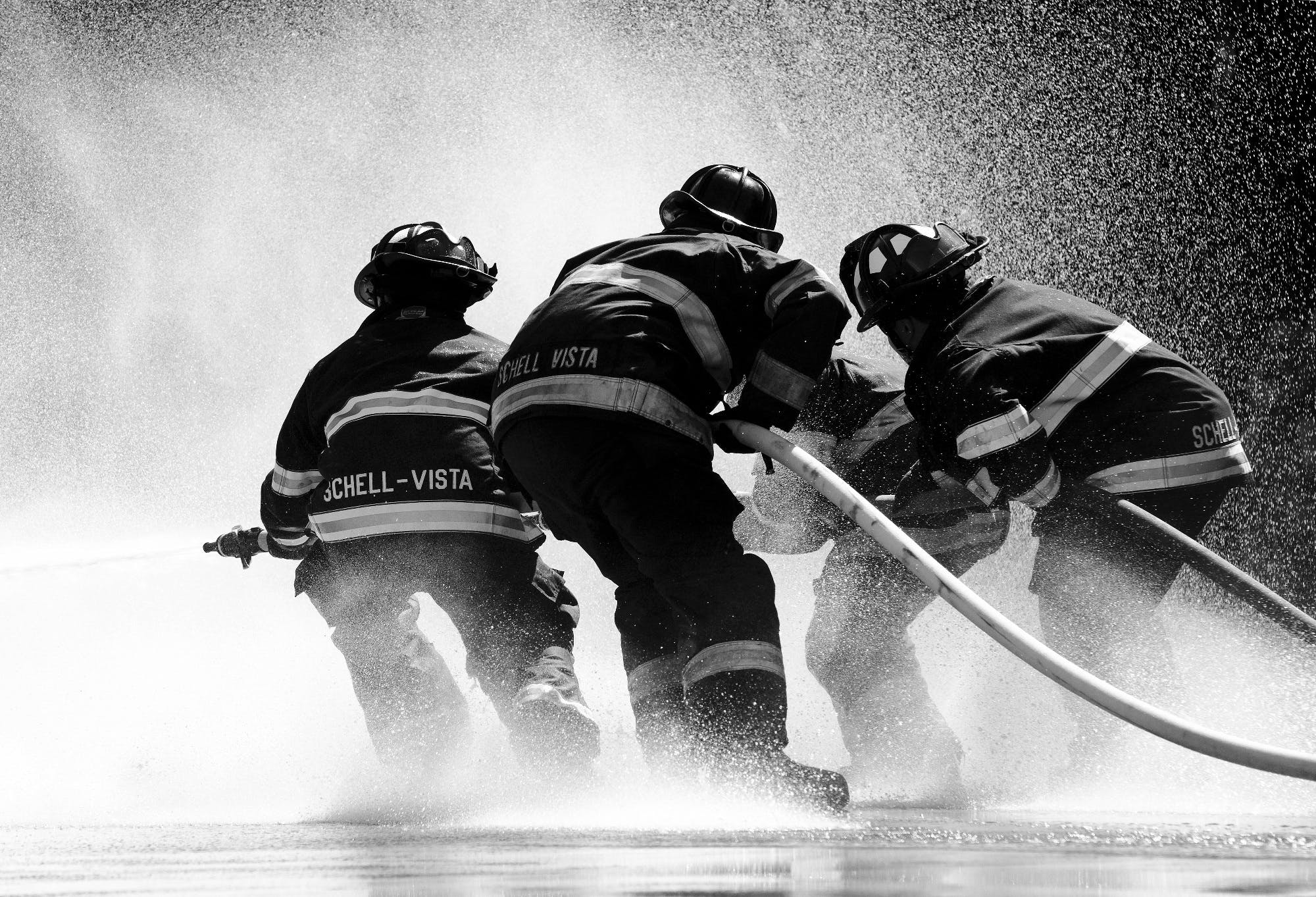 Grayscale Photo of Firemen