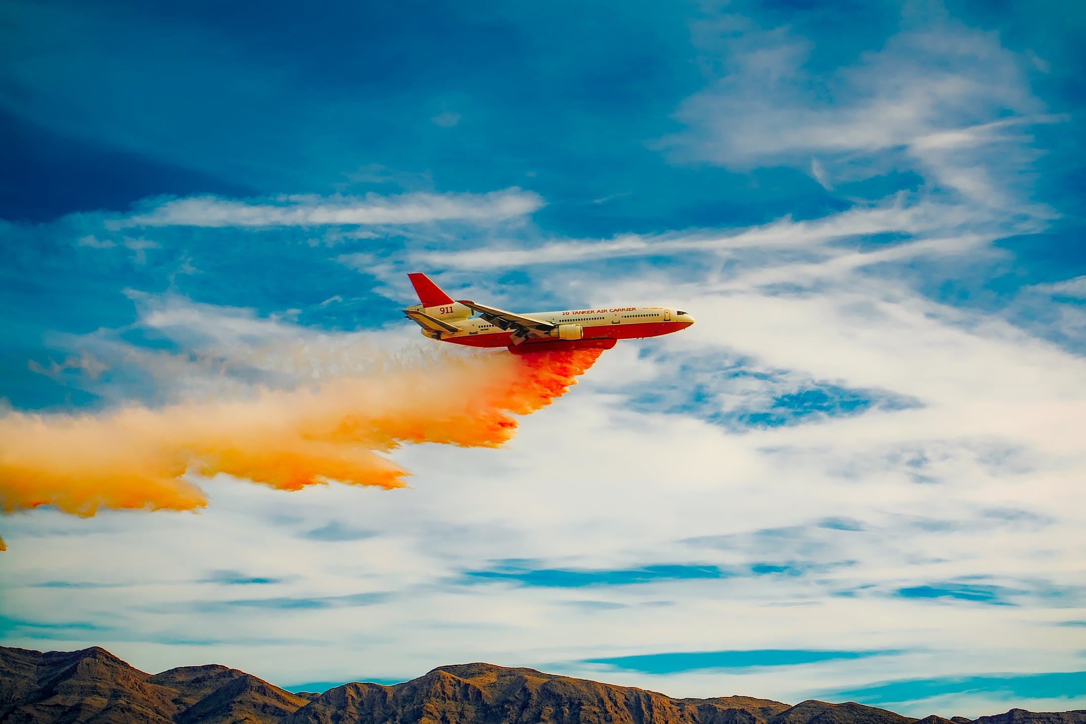 White and Red Passenger Airplane Under White Sky