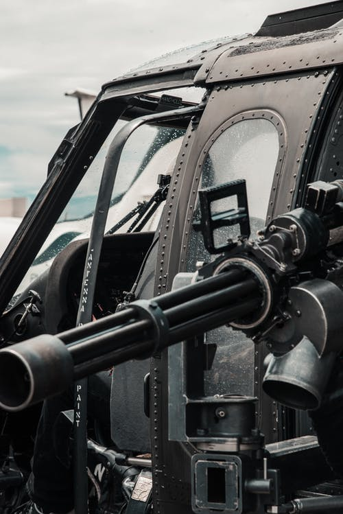 Close-up Photo of Black Helicopter With Black Machine Gun