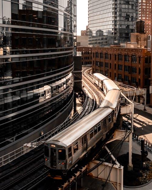 Photo of Grey Bridge Train Beside Glass Building
