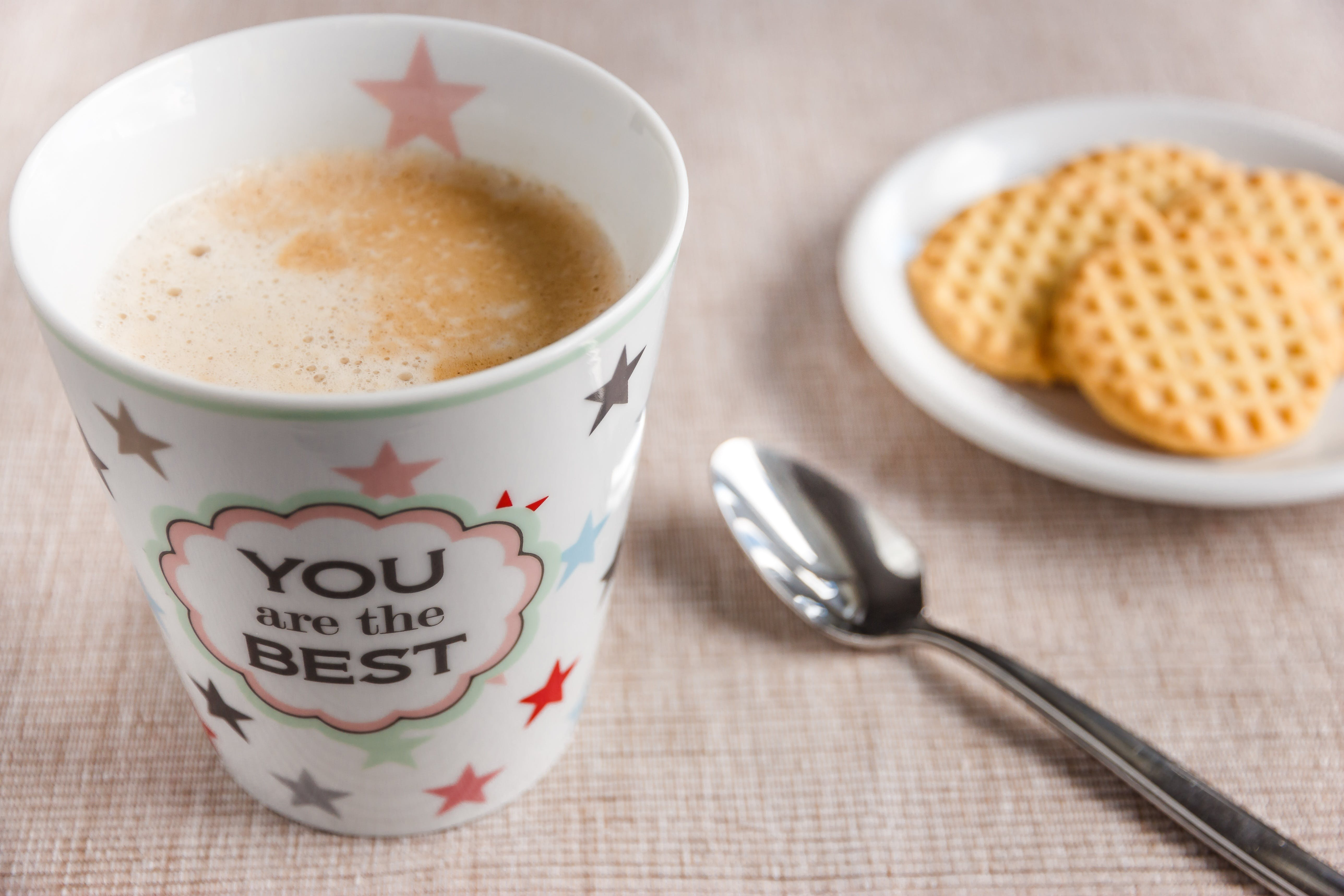White Printed Cup and Silver Spoon