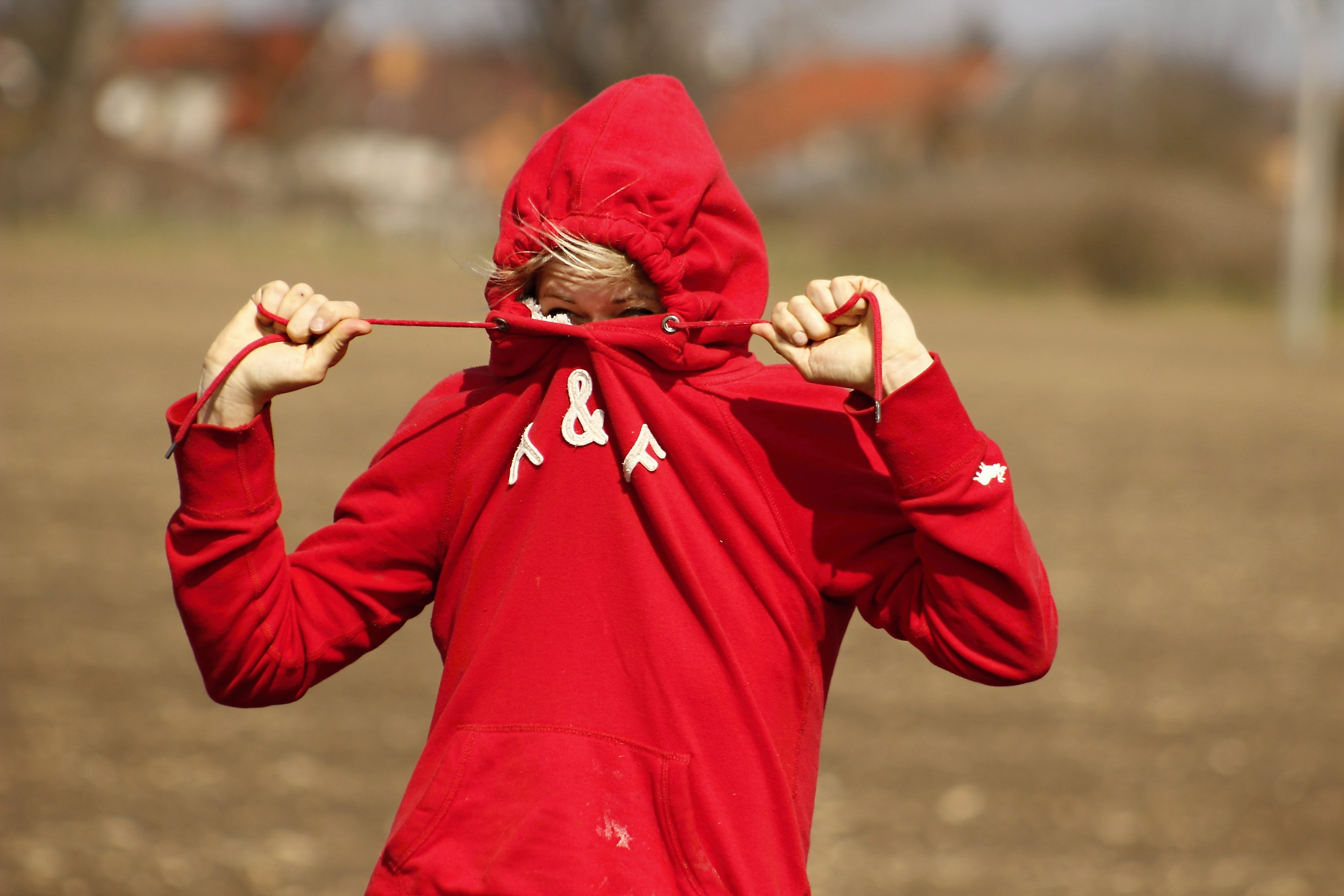 Person Wearing Red A&f Pullover Hoodie