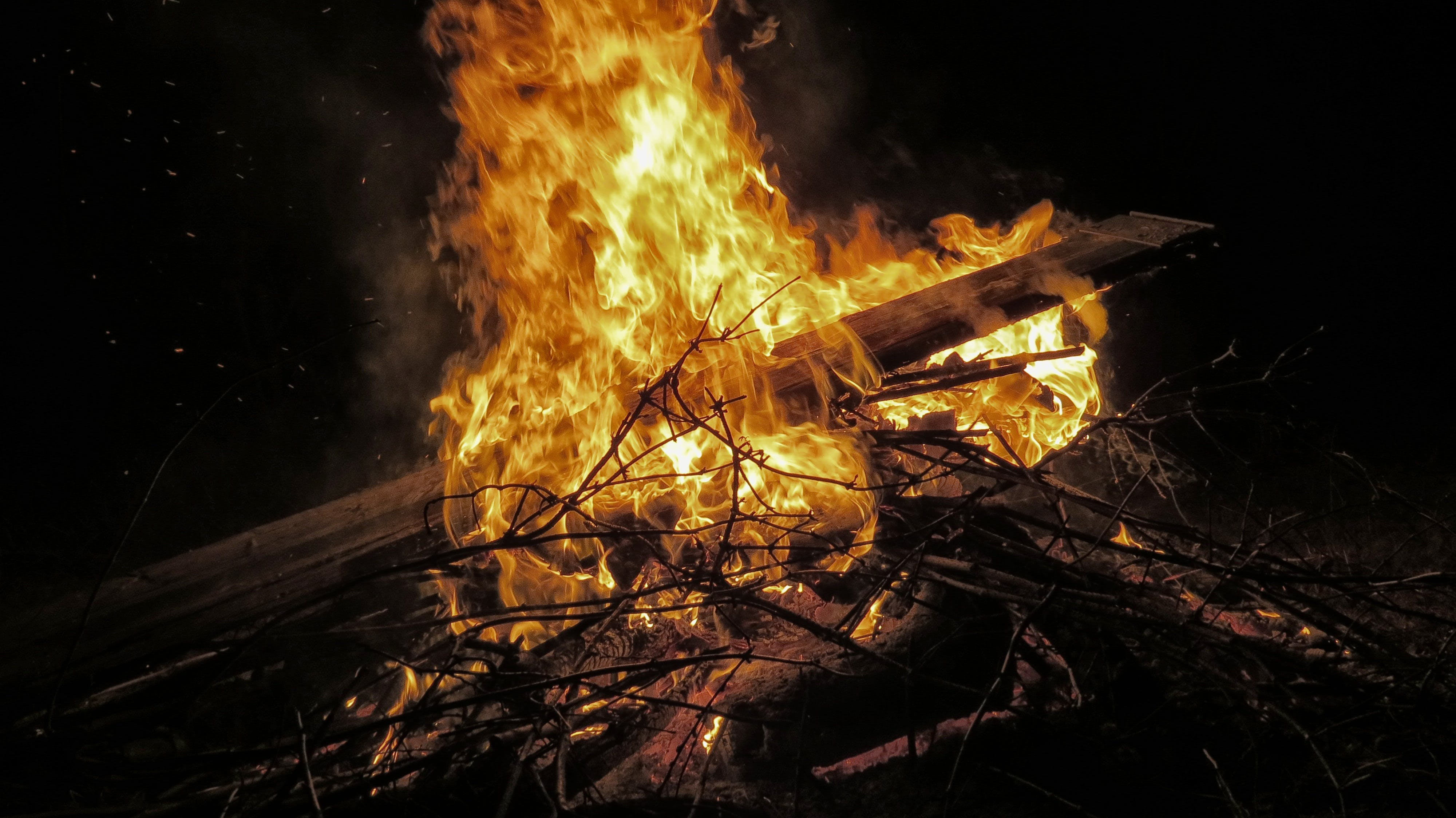 Burning Twigs and Wood Plank