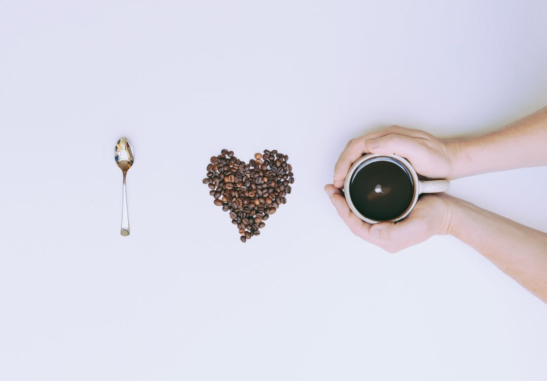 Flat Lay Photography of Mug and Coffee Bean