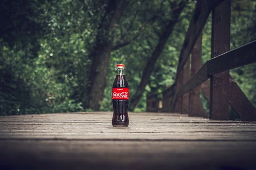 Selective Focus Photography of Coca-cola Bottle