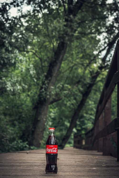 Selective Focus Photo of Coca-cola Bottle
