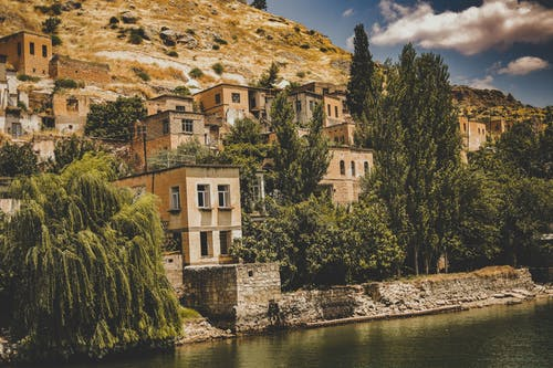 Free stock photo of houses, old structure, river, sky
