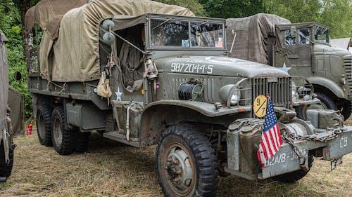 Kostnadsfri bild av armén, bil, däck, gräs