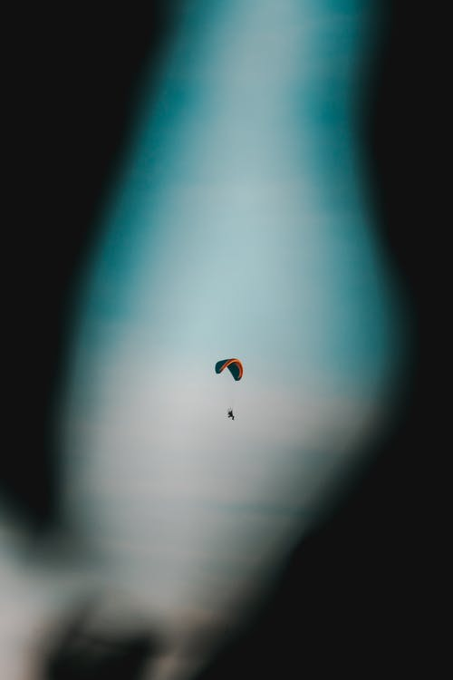 Selective Focus Photo of Person Paragliding