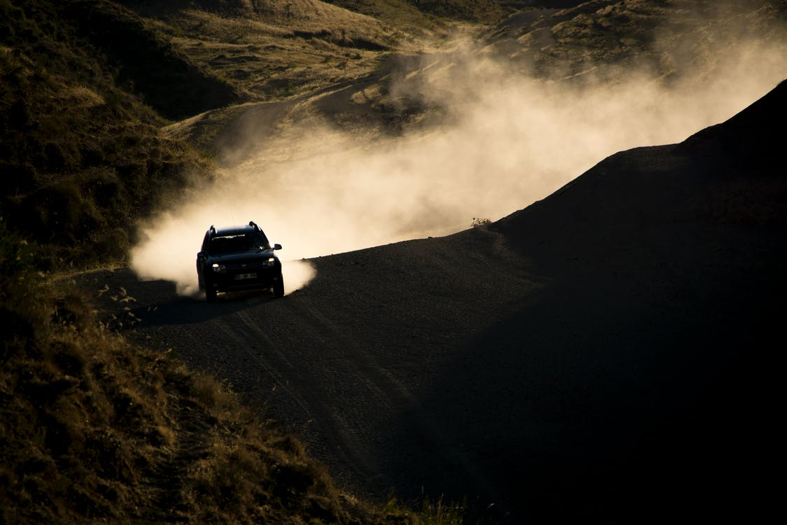 Photo of Car on Dirt Road