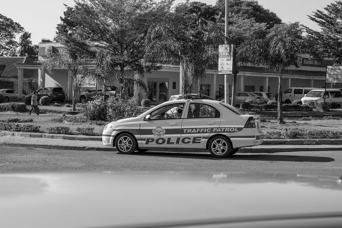black and white, police car