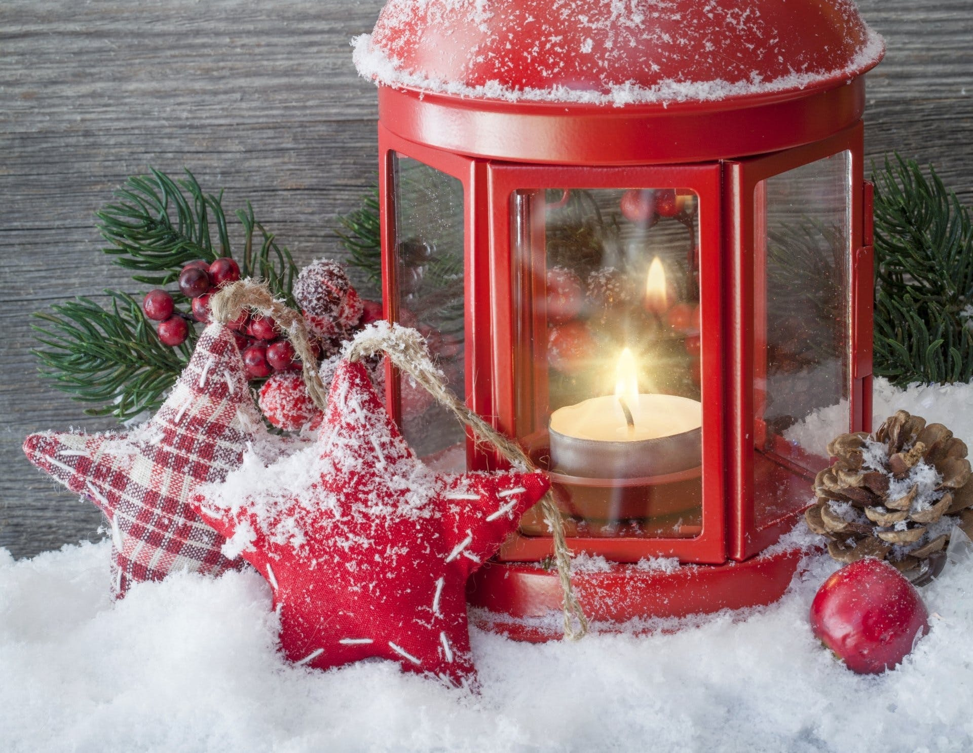 Lighted White Tealight Candle Inside Red Metal Lantern