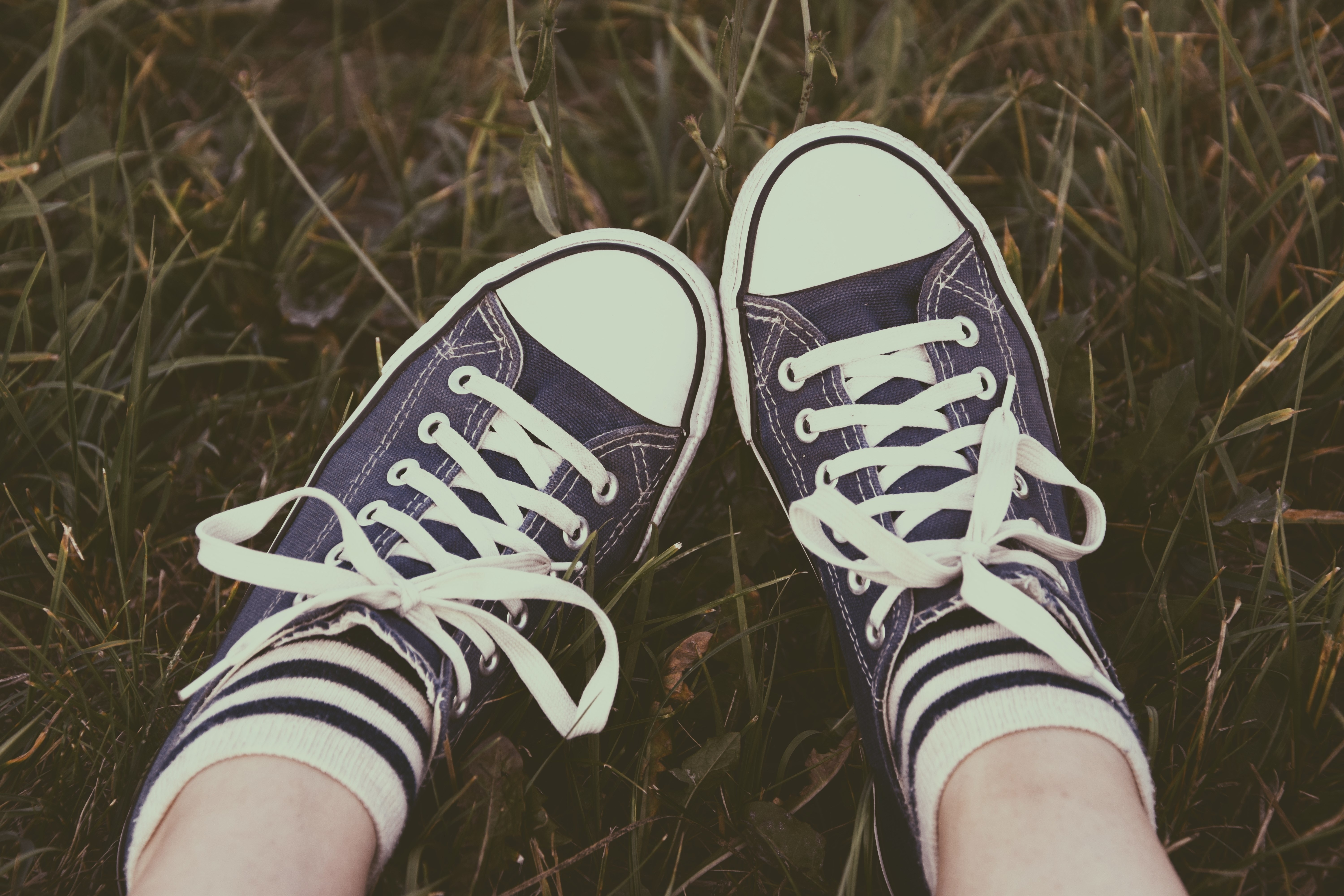 f8ff39e4b2d Person Feet Wearing Black Converse All-star Low-tops · Free Stock Photo